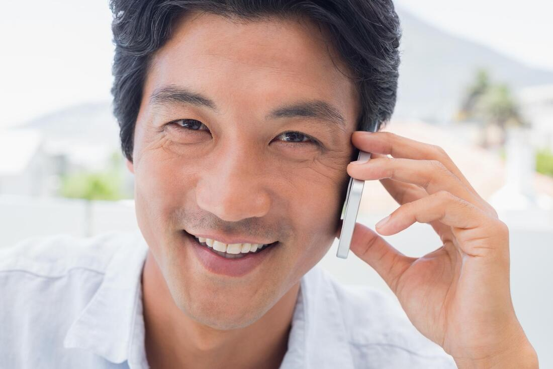 man smiling in the phone